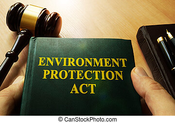 Hands holding environment protection act in a court.