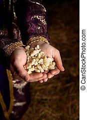 Hands holding Frankincense - Palms together holding a...