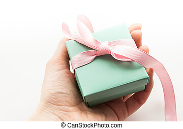 Hands holding gift box isolated on white background.
