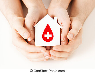 hands holding house with donor sign - healthcare, medicine ...