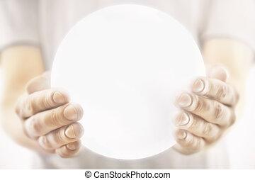 Hands holding illuminated sphere