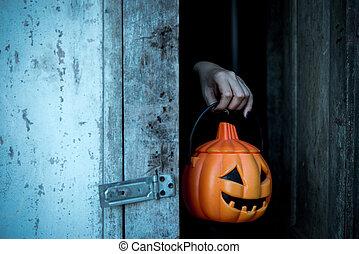 Hands holding lantern giant pumpkin