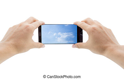 Hands holding mobile smart phone with sky in screen. Cloud computing concept
