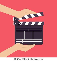 Hands holding movie clapper