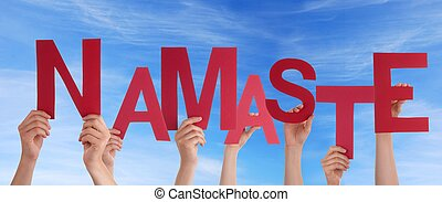 Hands Holding Namaste - Many Hands Holding a Red Namaste in...