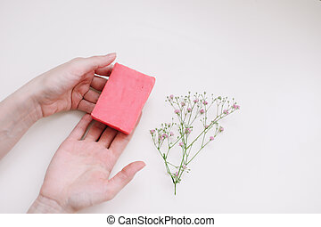 hands holding natural organic soap top view