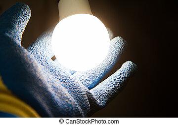 Hands holding new Light Emitting Diode ( LED ) light bulb ...