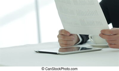 Hands holding paper - Smiling businessman in a meeting....