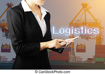 Hands holding phone over container cargo freight ship with working crane bridge in shipyard