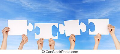 hands holding pieces of a puzzle with copy space
