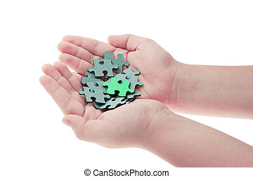 Hands holding pieces of jigsaw puzzle
