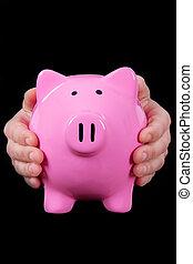 Hands Holding Piggy Bank