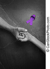 Hands holding purple ribbons top view