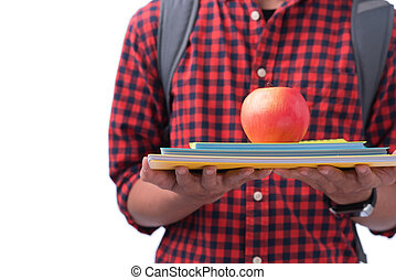 Hands holding red apple with book, isolated on white.