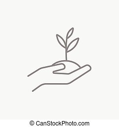 Hands holding seedling in soil line icon. - Hands holding...