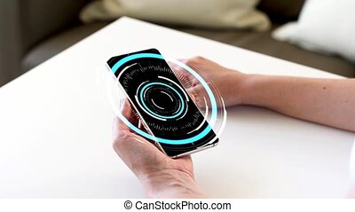 hands holding smartphone with virtual hologram