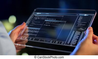 hands holding tablet pc with coding on screen - technology,...