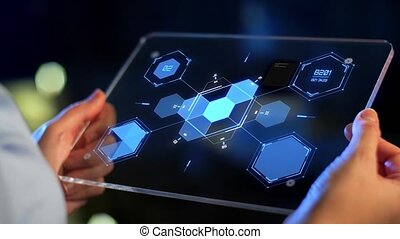 hands holding tablet pc with virtual projections -...
