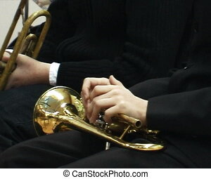 Hands holding the trumpet