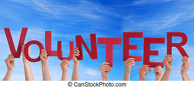 Volunteer in the Sky - Hands Holding the Word Volunteer in...