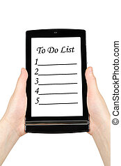 Hands holding touch screen tablet with to do list on screen