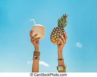 Hands Holding Tropical Fruits Over Sky Background