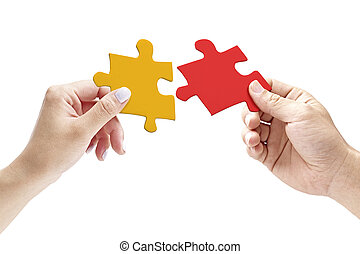 hands holding two matching jigsaw pieces
