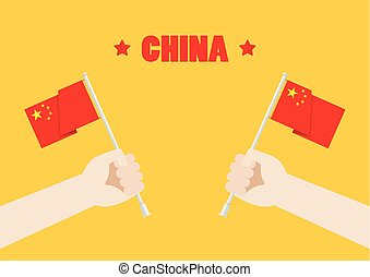 Hands holding up China flags
