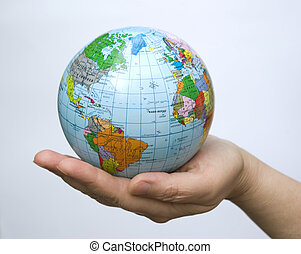globe - Hands holdings a globe on a whiteness