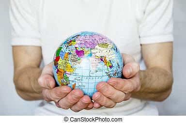 Hands holdings globe