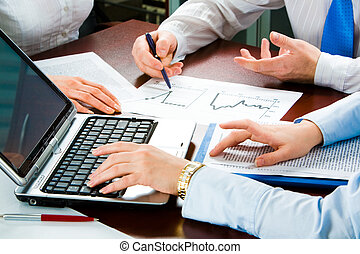 Hands - Image of three business people�s hands at working...