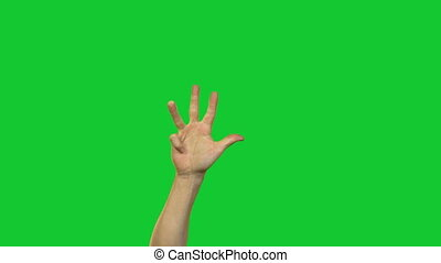 Hands in counting to ten on green background - Footage of...