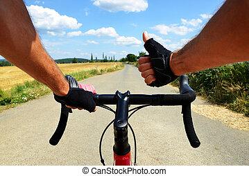 Cyclist rides on a road bike.
