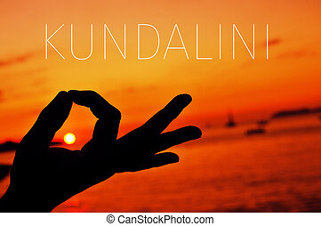hands in gyan mudra and text kundalini - closeup of a young...