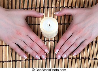 Hands in heart-shape with candle