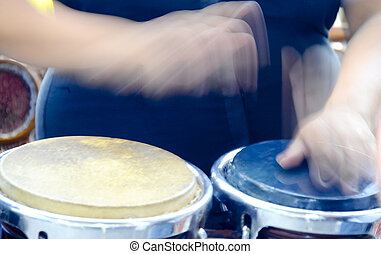 Bongo Drums - Hands in motion playing Bongo Drums