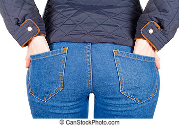 Young female hands in the jeans pockets