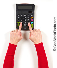 Hands in red jacket and black calculator