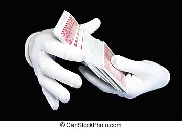 Hands in white gloves with a pack of playing cards on a...