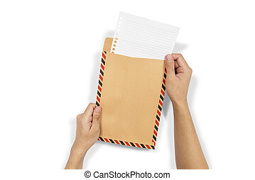 Hands insert the paper into brown envelope