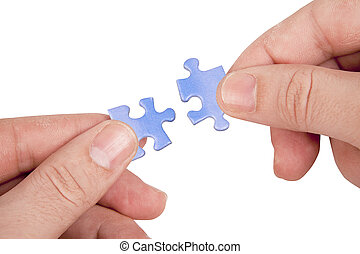 hands joining puzzle pieces