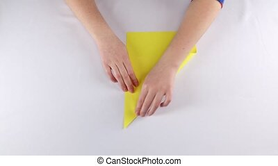 Hands make origami. White. Time lapse - Hands make origami...
