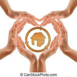 Hands make shape with wood house - Hands make shape with...