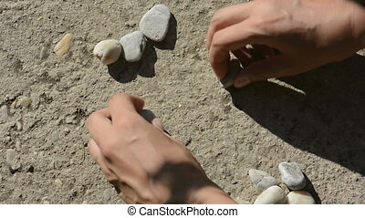 Hands makes little heart of stones - Human hands makes...