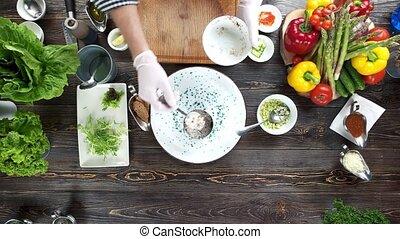 Hands making food, herring tartare. Dinner preparation,...