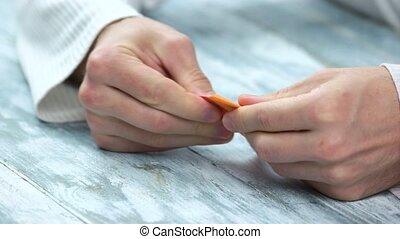 Hands making four pointed shuriken origami. Beautiful figure...