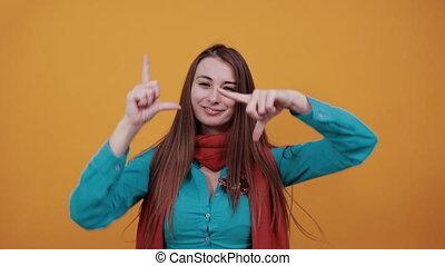 Hands making photo frame, fingers framing distance, ...