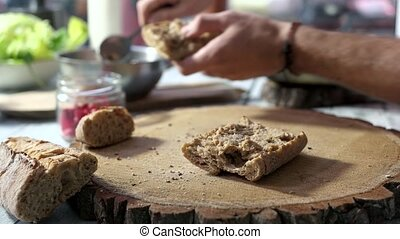Hands making sandwich. Bread and duck pate. Best home...