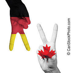 Hands making the V sign with painted flag