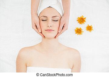 Hands massaging a beautiful woman's